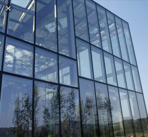 How are glass curtain walls produce?